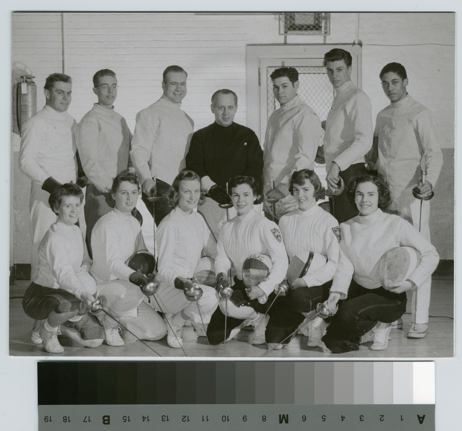 Student activities, group portrait of the RIT fencing team with their coach Fritz Florescue, 1953