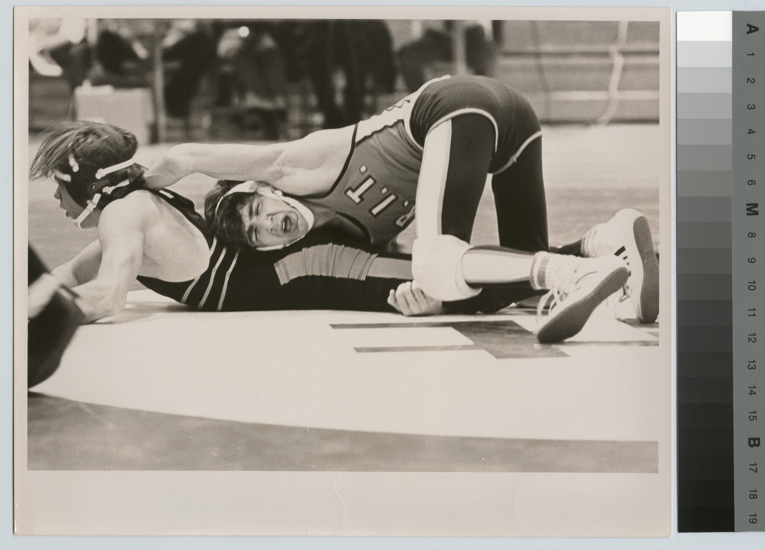 Student activities. Wrestling match between a Rochester Institute of Technology wrestler and an unidentified opponent, [1968-1980]