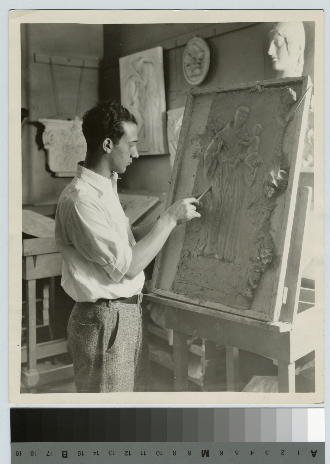 Unidentified student models a relief panel, Department of Applied and Fine Arts, Rochester Athenaeum and Mechanics Institute