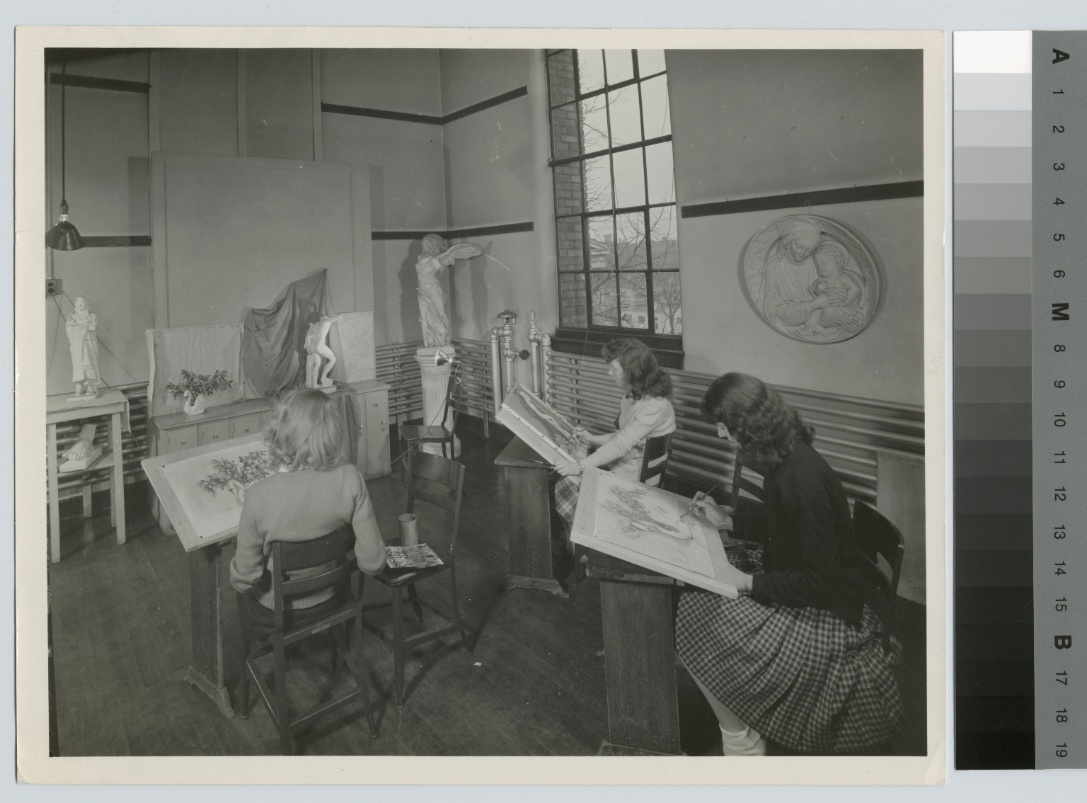 Academics, Art and Design. Three female students in a painting class.