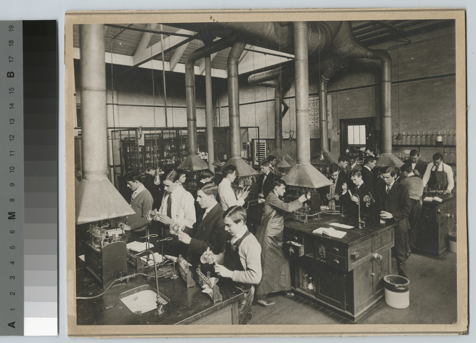 Academics, chemistry. Rochester Athenaeum and Mechanics Institute chemistry laboratory with students working on experiments, [1900-1920]