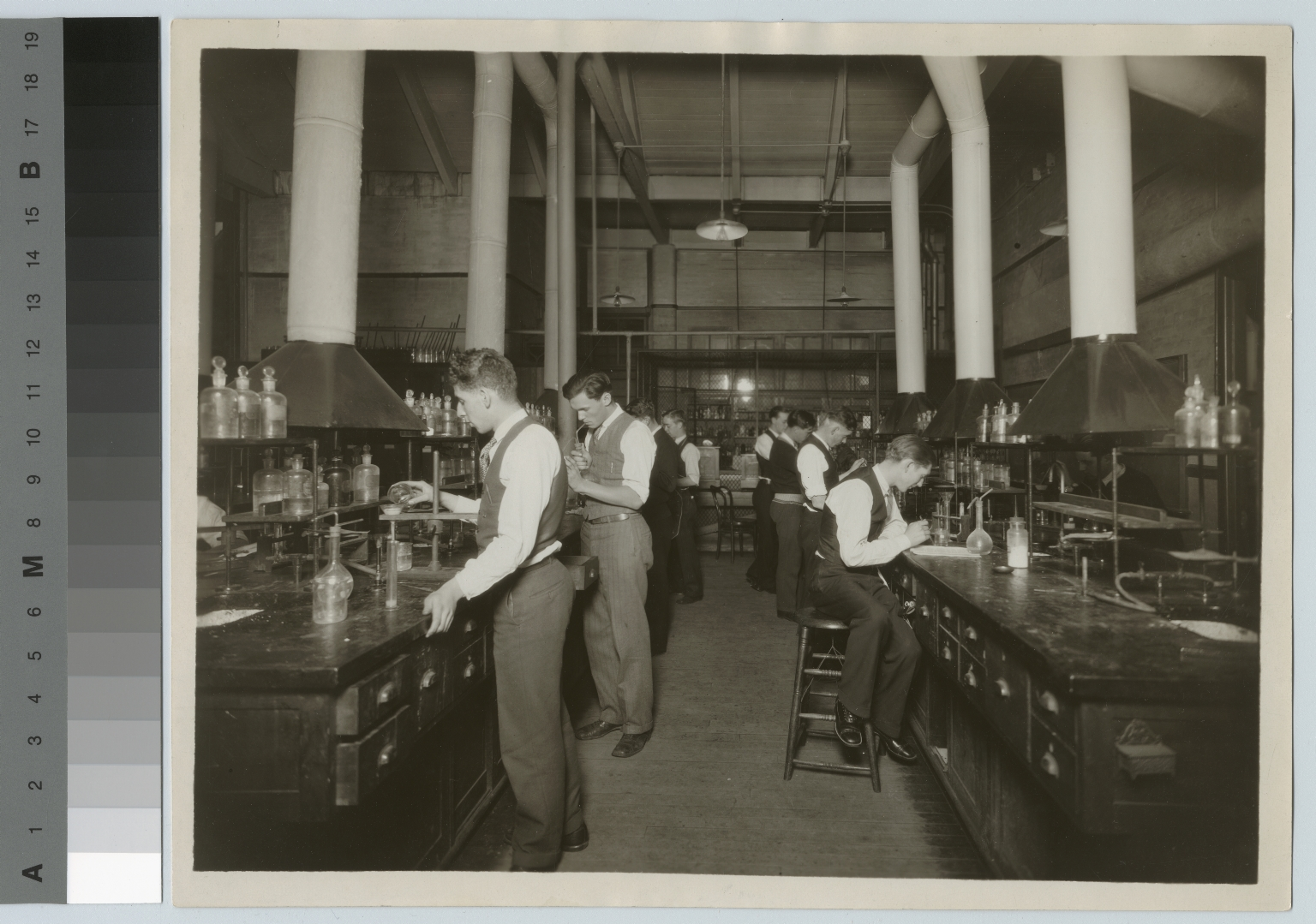 Academics, chemistry, Rochester Athenaeum and Mechanics Institute chemistry laboratory with male students work on experiments, [1920-1930]