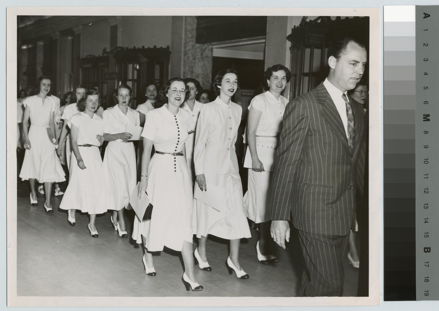 Unidentified students arriving for convocation, Rochester Institute of Technology, Eastman Theatre [1949]