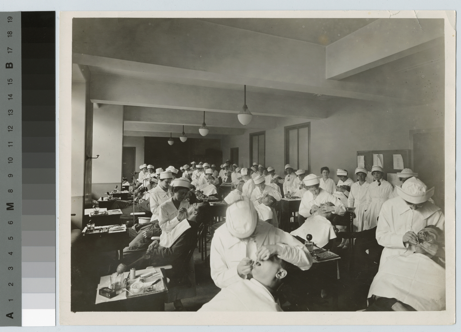 Dental students practicing on patients, Rochester Athenaeum and Mechanics Institute [1930-1940]