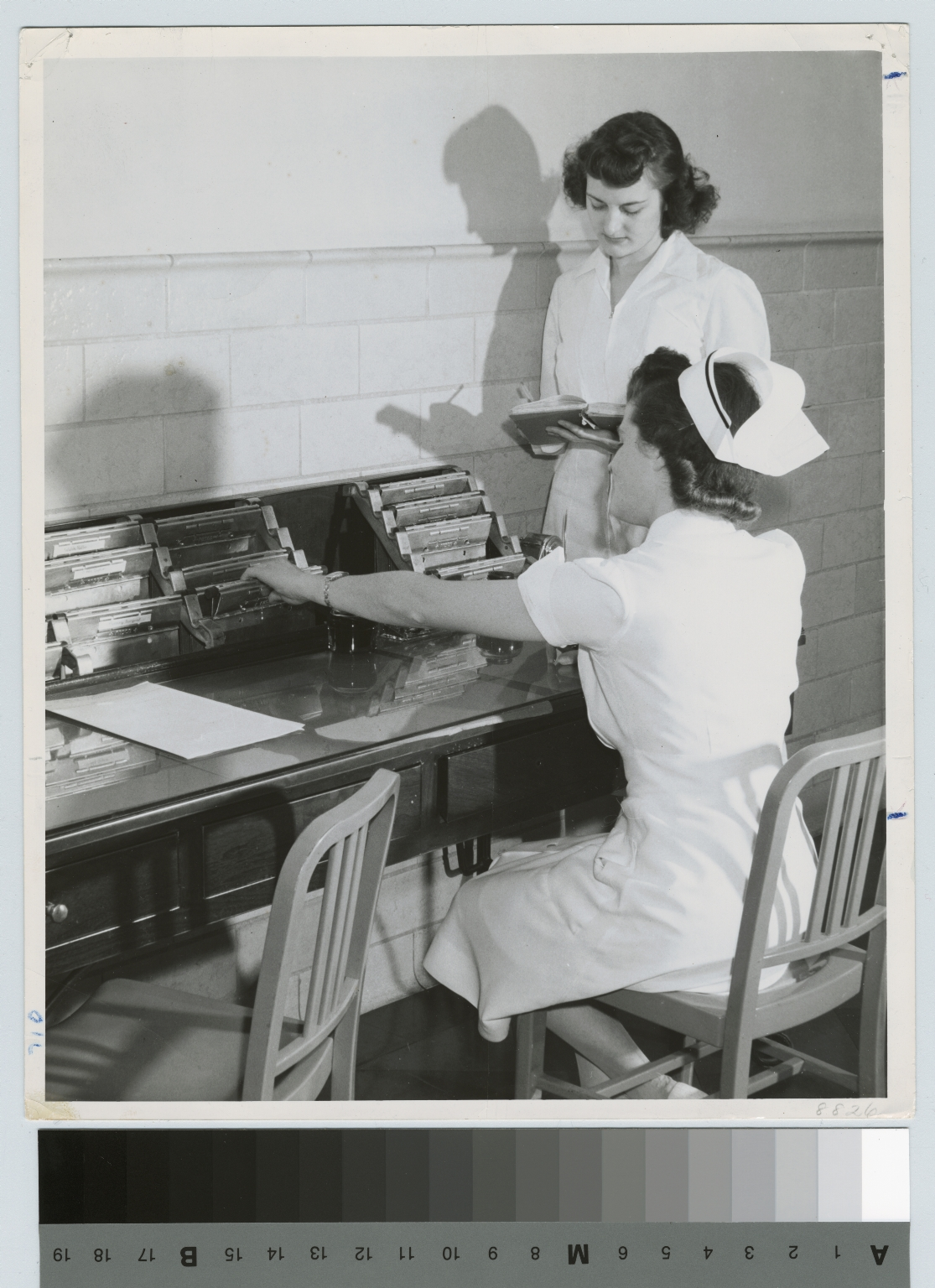 Academics, Food Administration student confering with a nurse at Monroe County Hospital, 1942