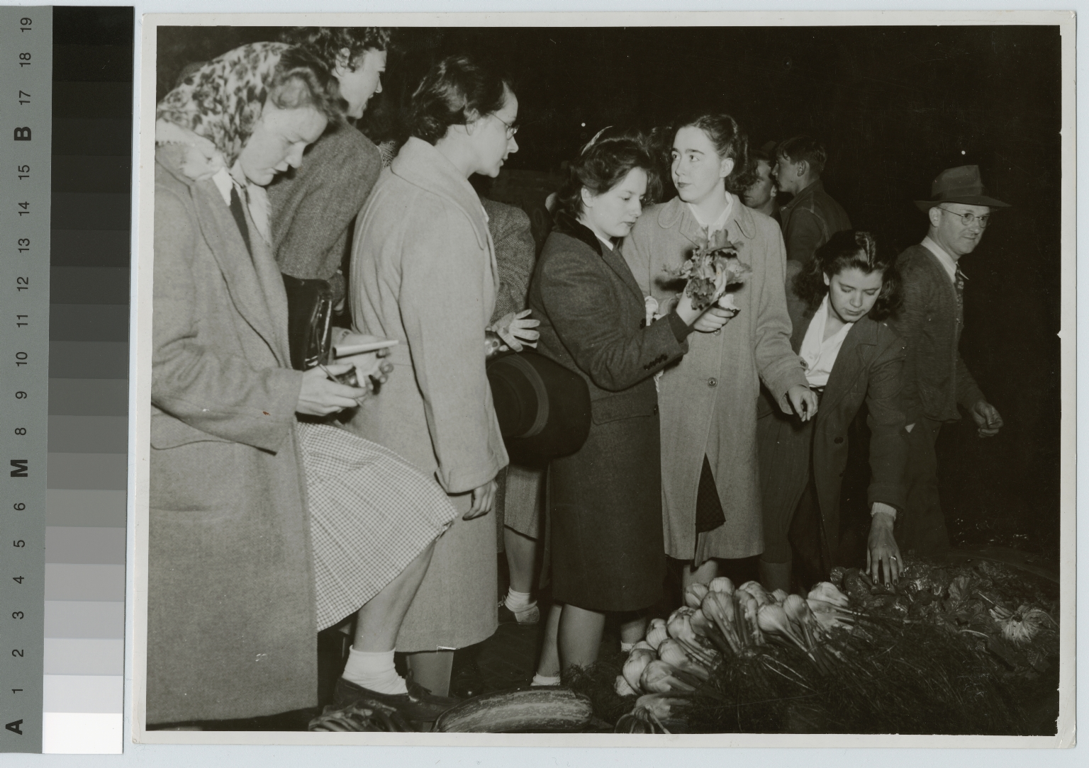 Academics, Food Administration students examining vegetables at the Rochester Public Market [1944-1946]