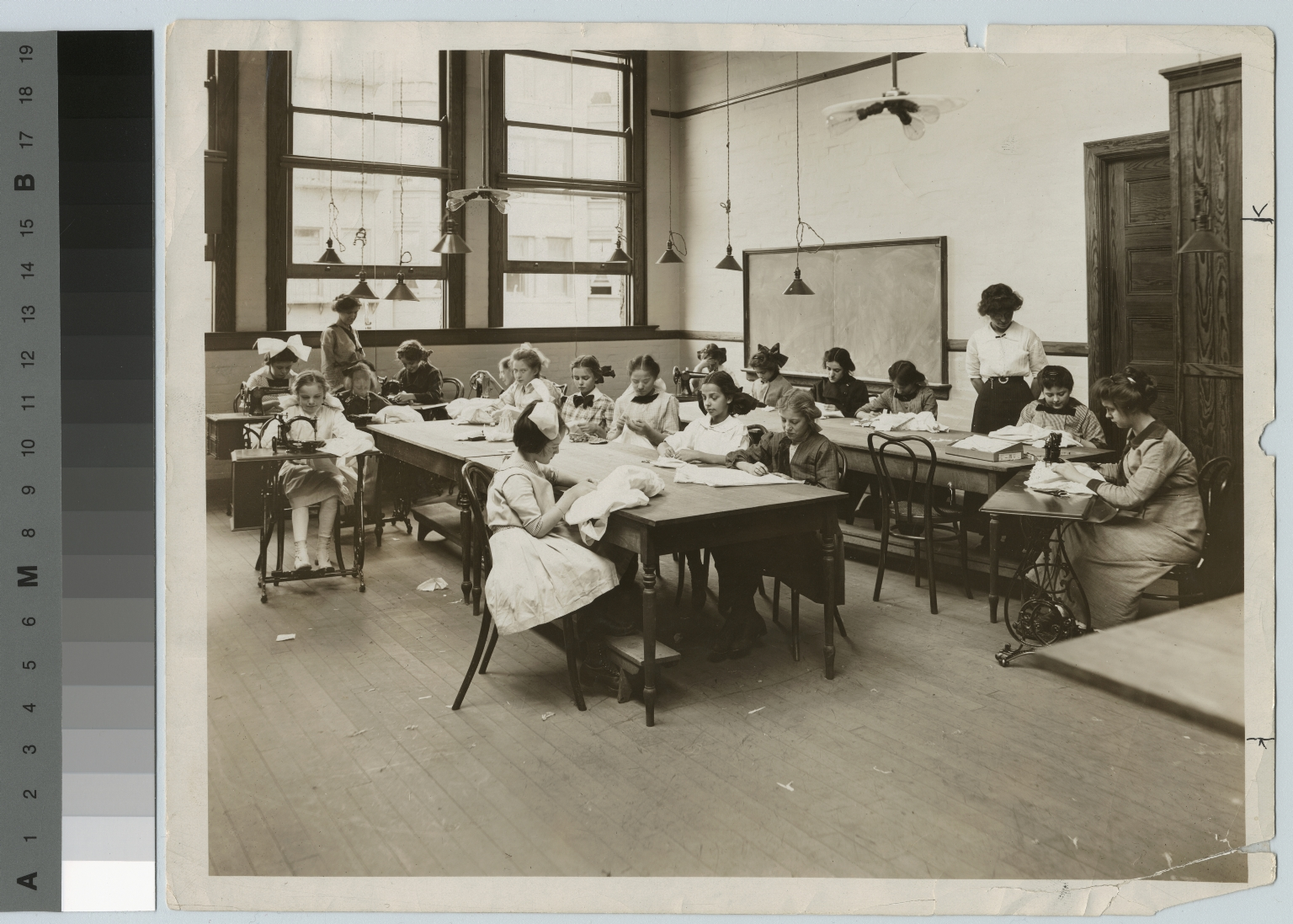 Students teaching a sewing class for young girls, Department of Household Arts and Sciences, Rochester Athenaeum and Mechanics Institute [1900-1920]
