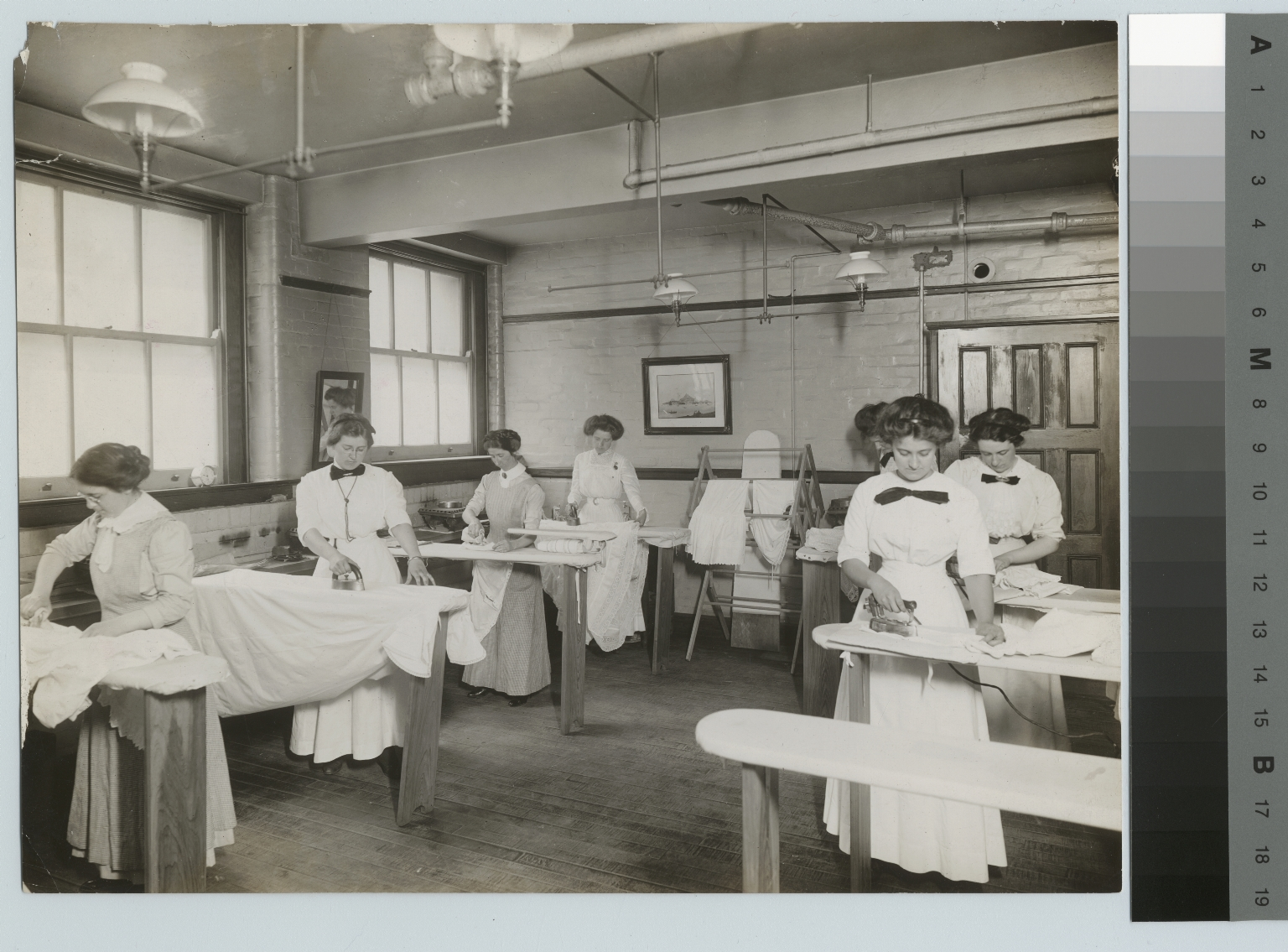 Students ironing sewing class, Department of Domestic Science and Art, Rochester Athenaeum and Mechanics Institute [1900-1915]
