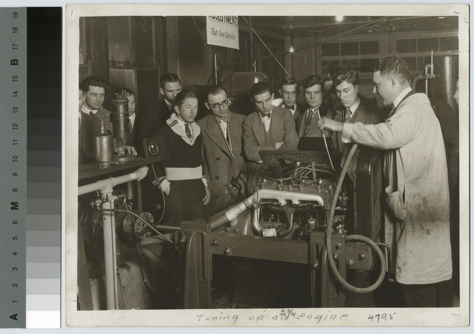 Students tuning an engine, School of Industrial Arts, Rochester Athenaeum and Mechanics Institute