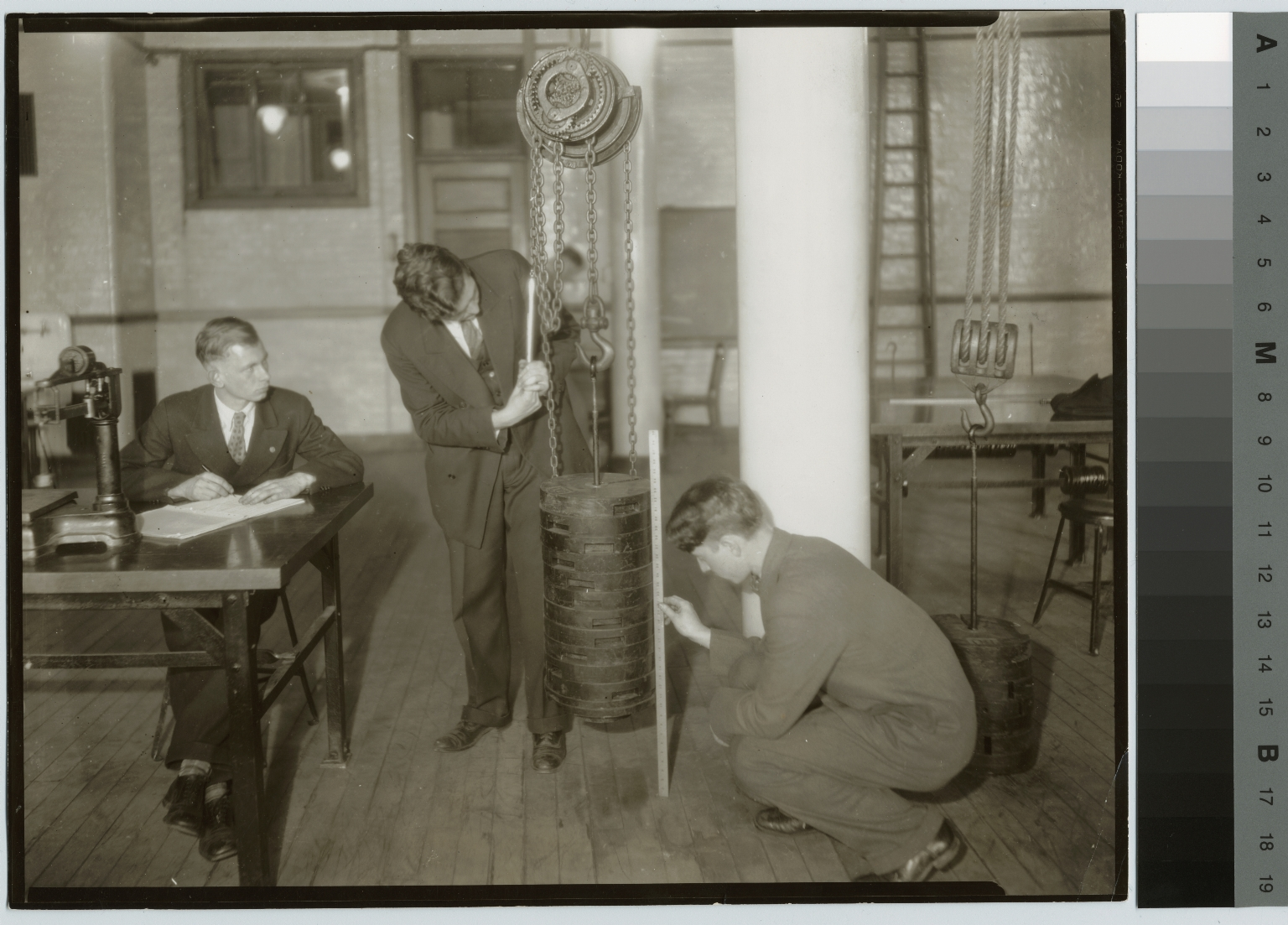 Unidentified students with chain hoist, School of Industrial Arts, Rochester Athenaeum and Mechanics Institute [1920-1935]