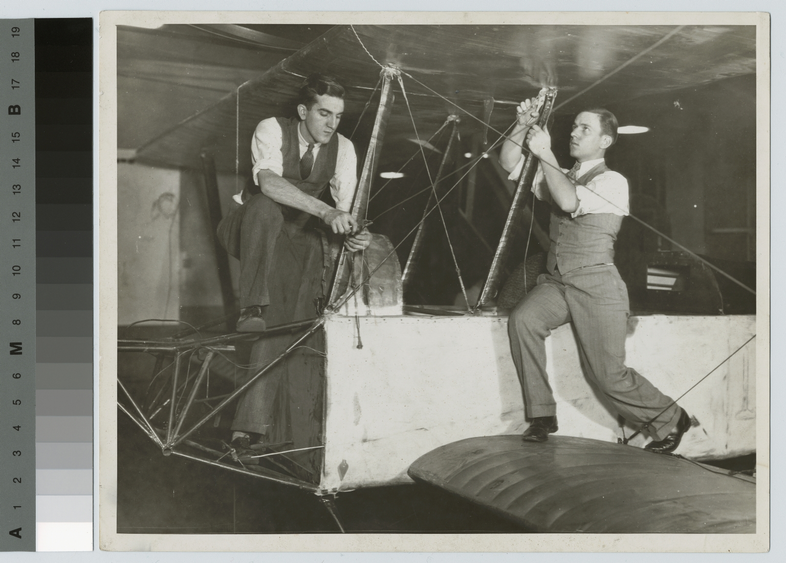 Students work on an airplane rigging, School of Industrial Arts, Rochester Athenaeum and Mechanics Institute