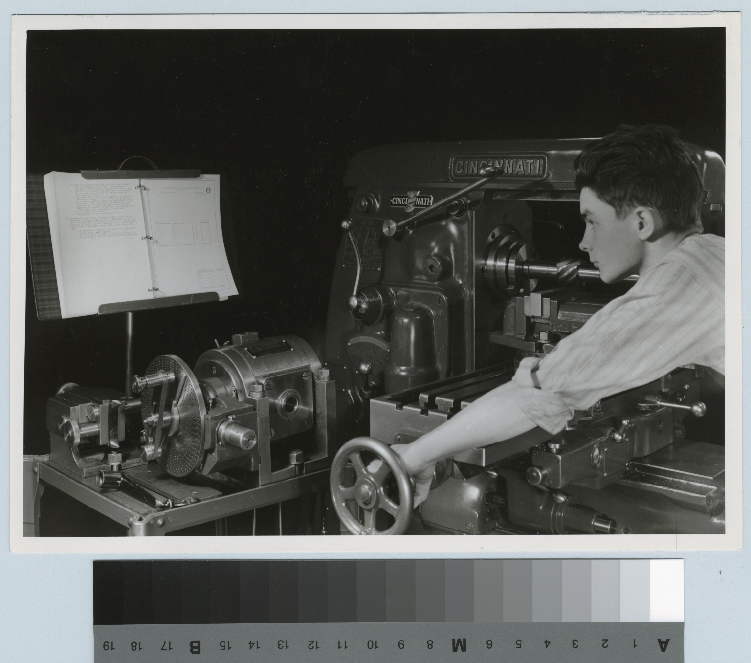 Unidentified student operating machinery, Mechanical Department, Rochester Institute of Technology