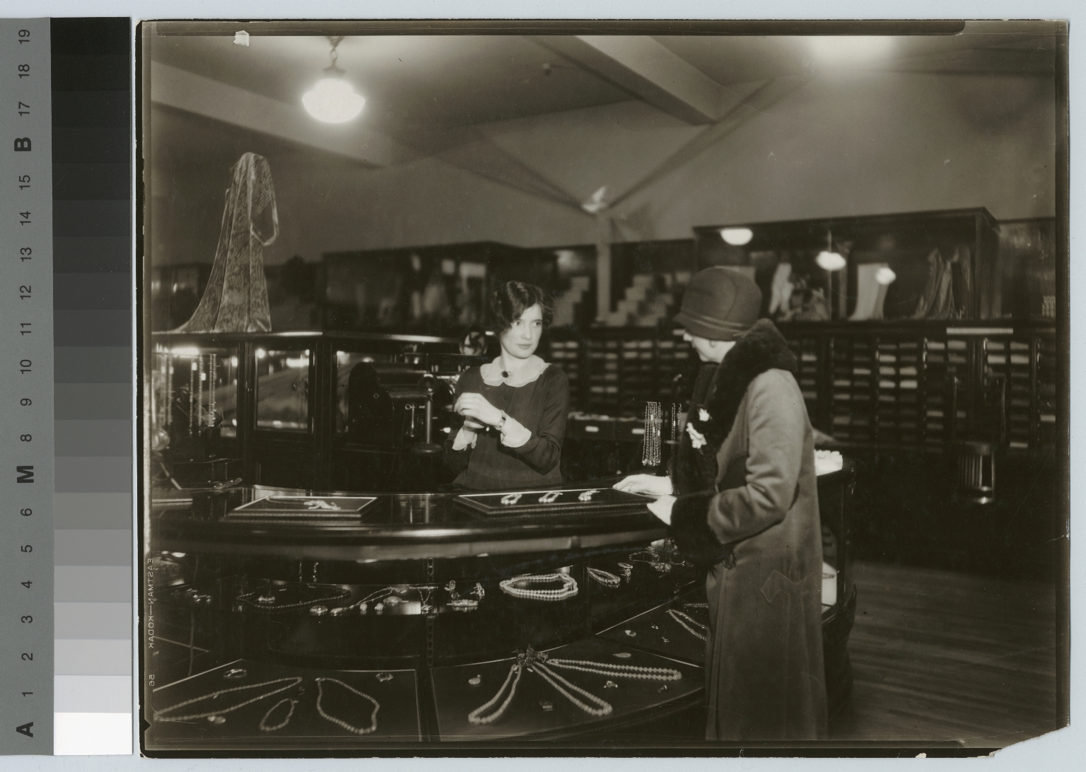 Cooperative student at jewelry counter, Retail Distribution course, Rochester Athenaeum and Mechanics Institute
