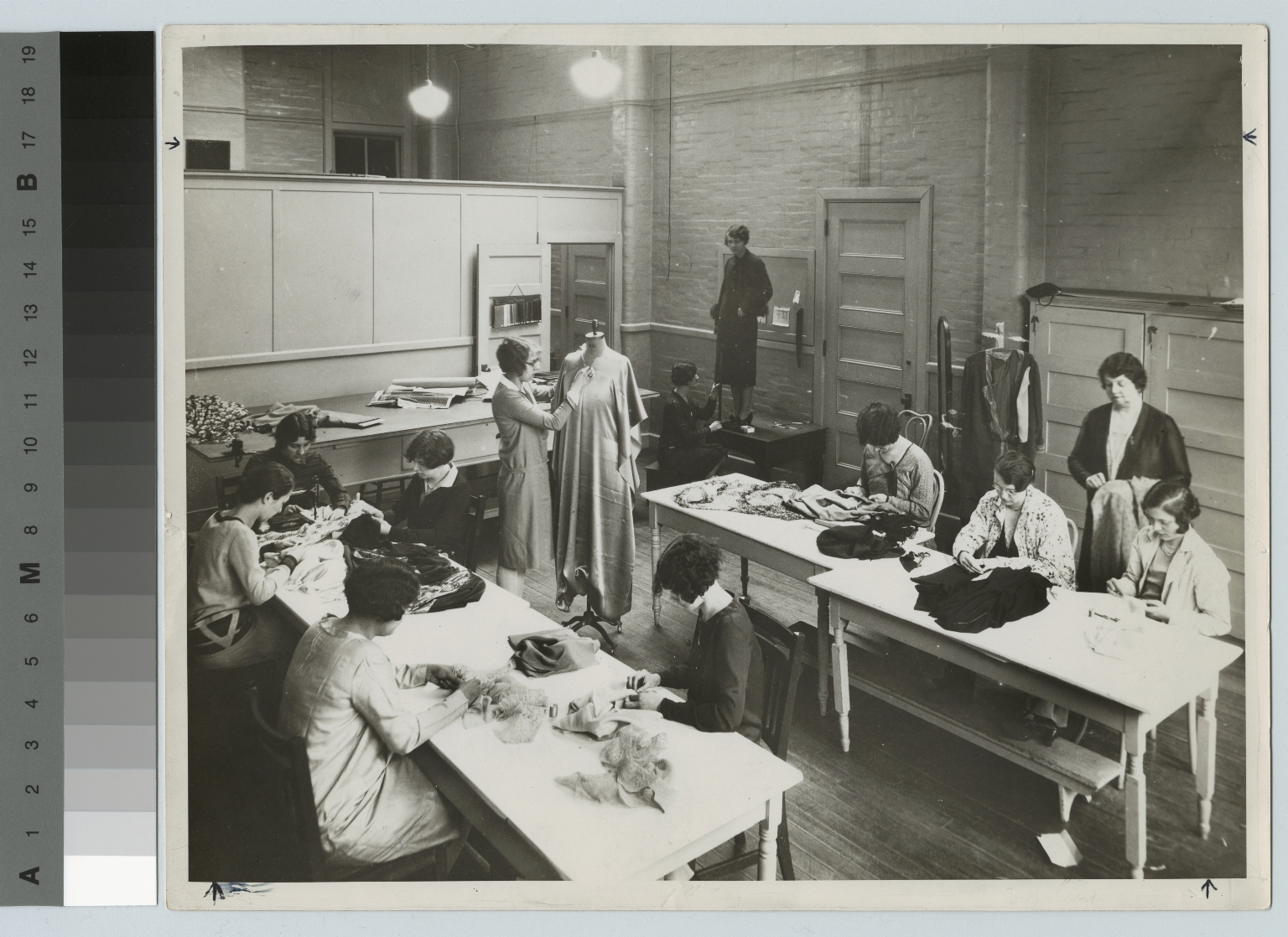 Students sew in clothing construction class, Retail Distribution Course, Rochester Athenaeum and Mechanics Institute