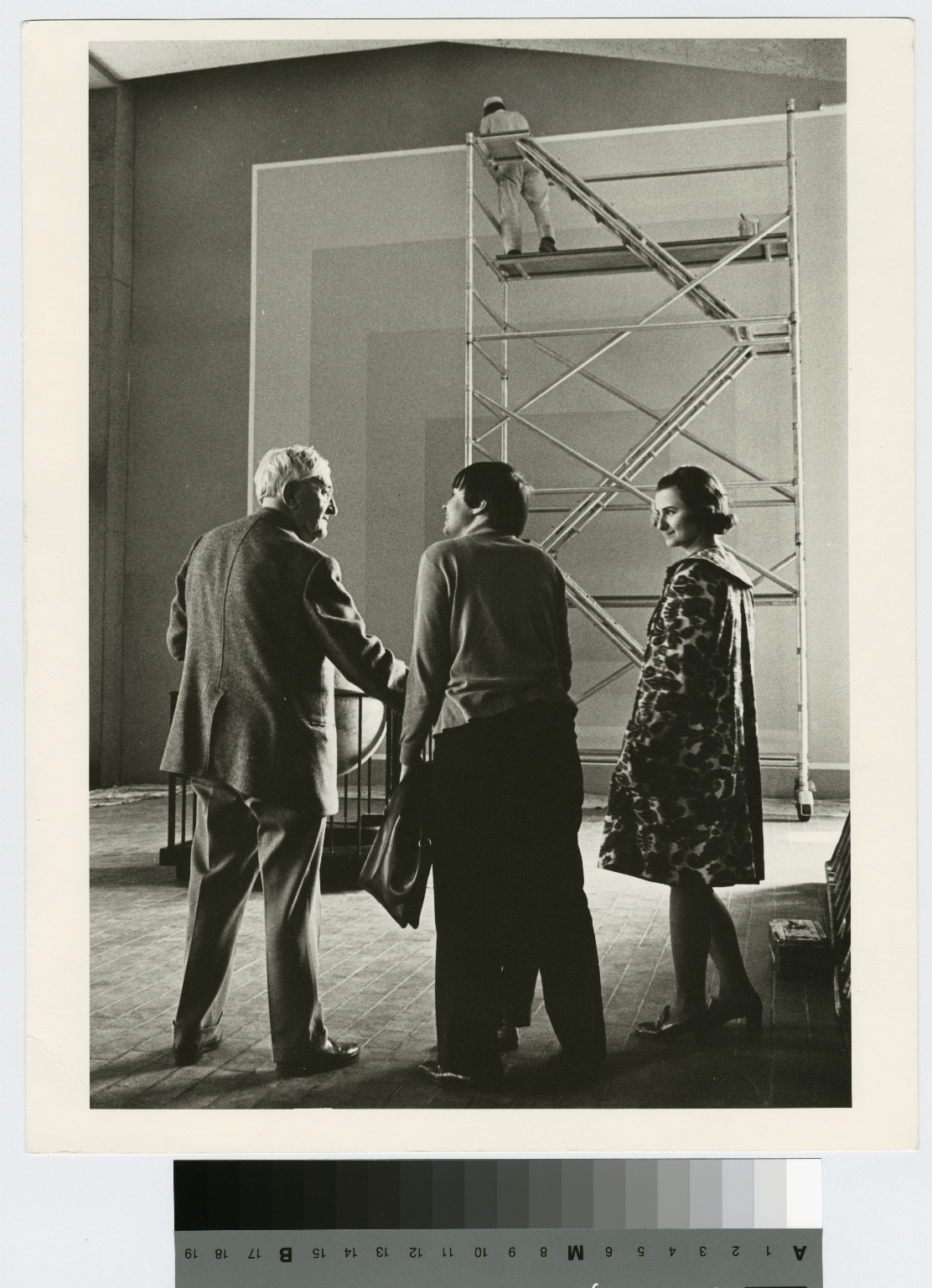 "Josef Albers and two unidentified students talk in front of his ""Homage to the Square"""