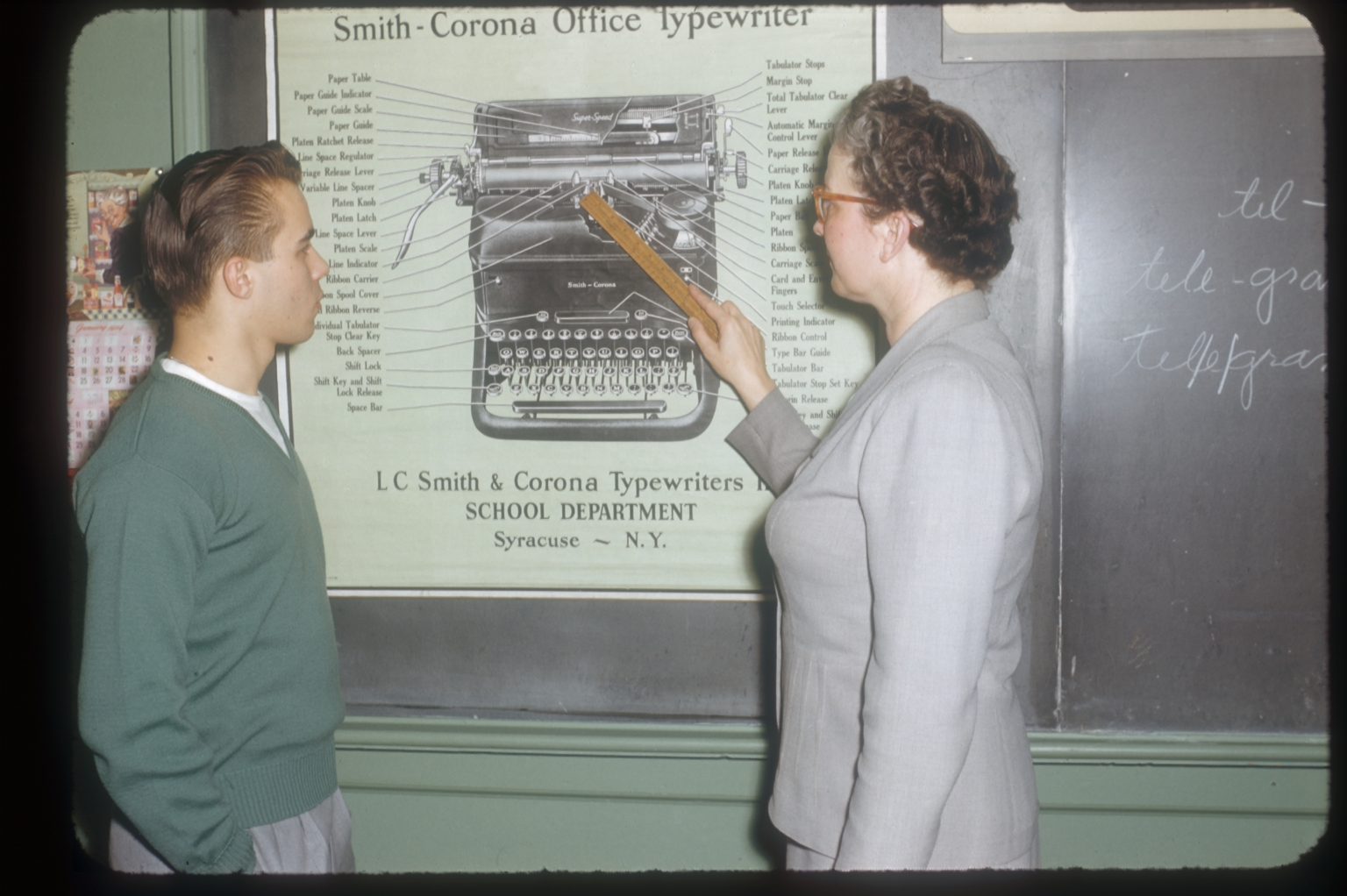 Business student receives instruction on the parts of a typewriter, Rochester Institute of Technology, January 1954