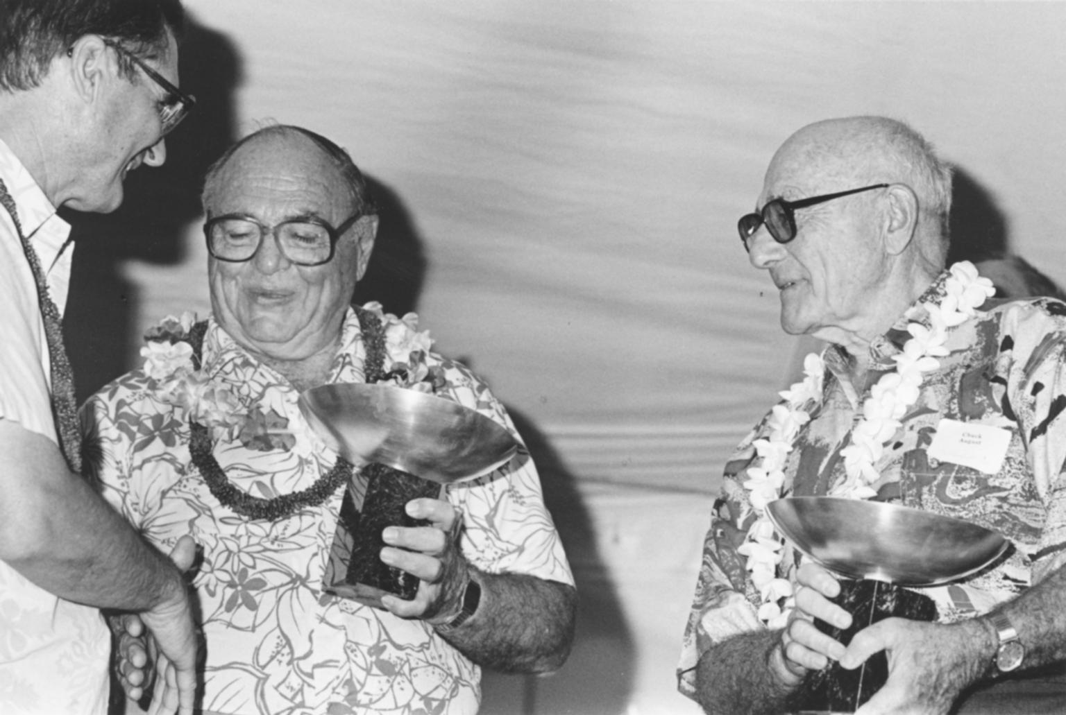 Burton S. and Charles August presented award by RIT President Albert Simone