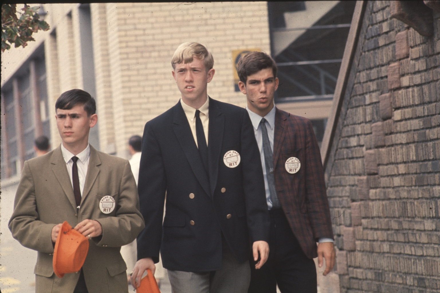 """Three male students wearing """"Frosh Daze"""" 1967 buttons"""