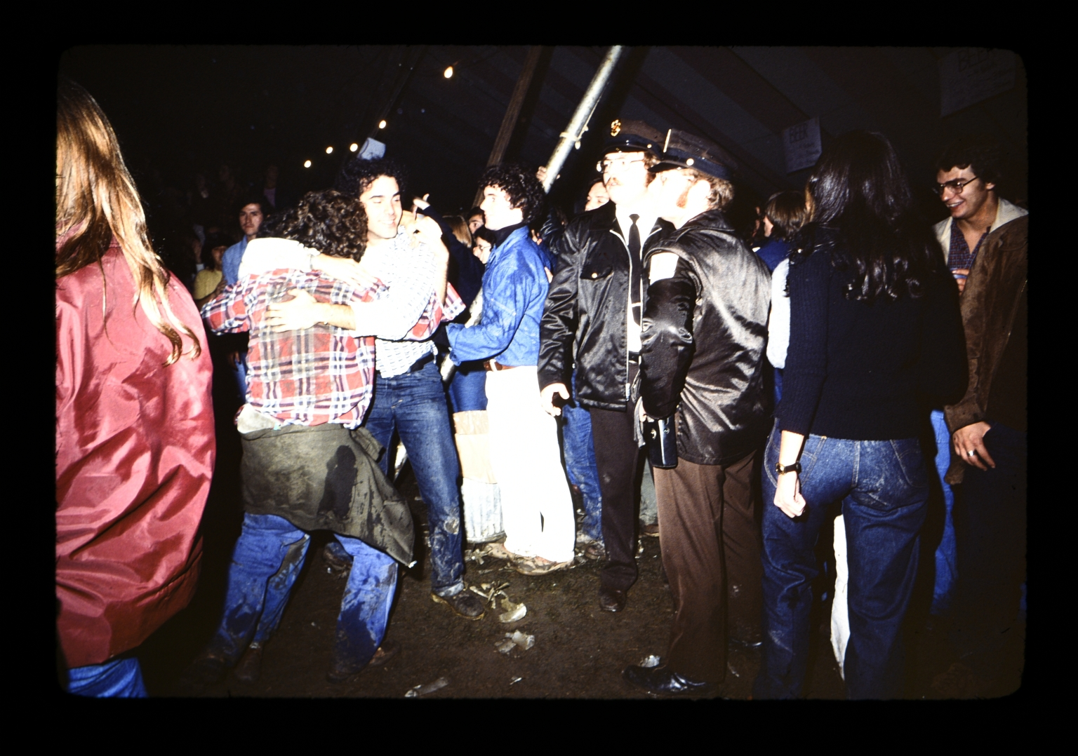 Unidentified students during a party beside security