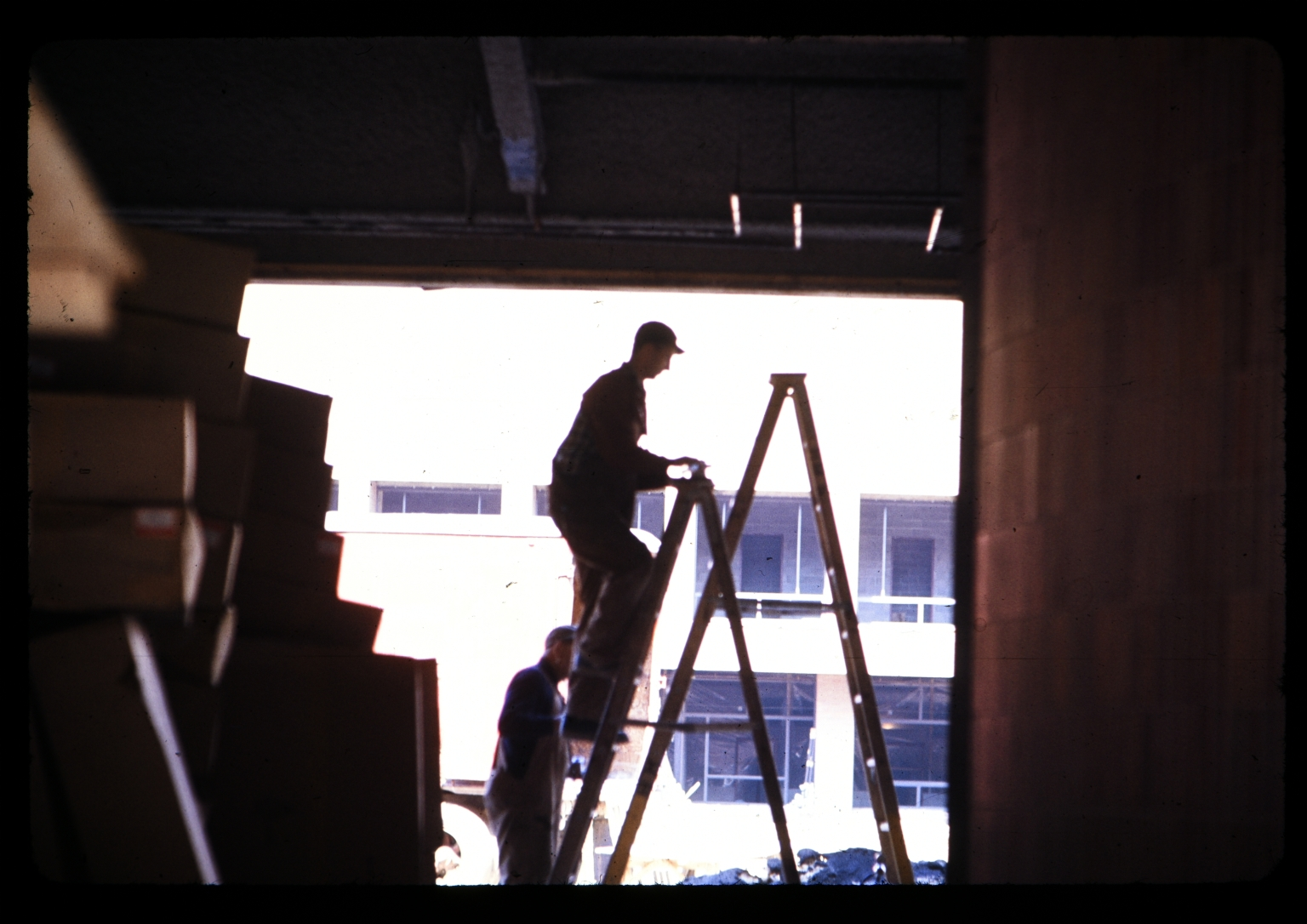 Construction workers on ladders
